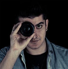 Man looking through camera lens